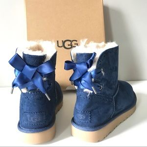 Ugg Dixi Flora perforated blue bow shearling boots